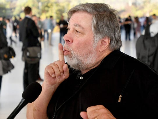 Apple co-founder Steve Wozniak motions to a camera