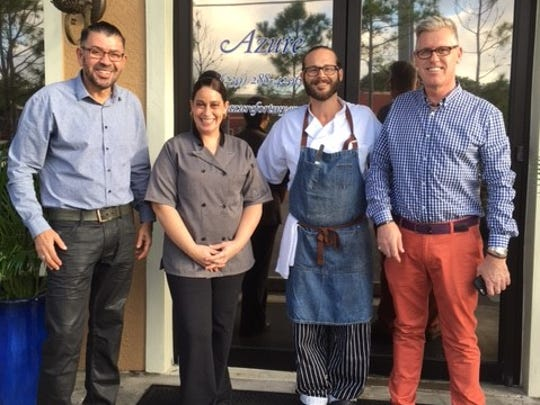 New owners Eddy Garces, left, and Lee Riley, right, with Chef Joe Pittman and sous chef Laurel Phelps at Azure.