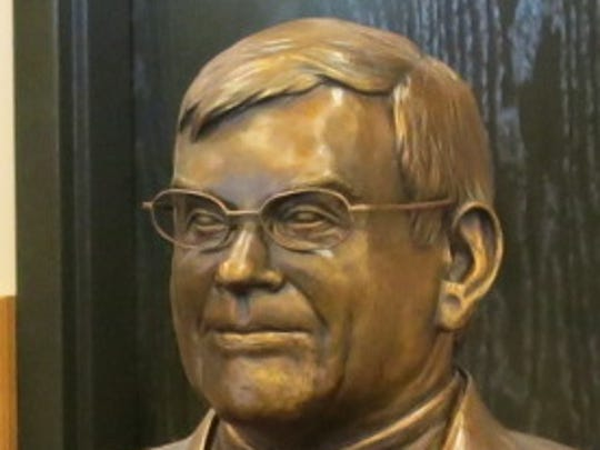 Bronze bust of Dr. Billy Bundrick Karl Malone presented