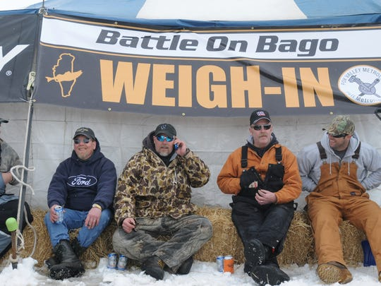 This group of ice fishermen, from left, Kevin Welch, Dennis Loertscher, Jeff Pomplun, Rick Stanton and his brother, Ryan, returned to the weigh-in tent early to avoid a long wait in line during the Battle on Bago ice fishing tournament in 2013. This year's event is Feb. 23 and 24.