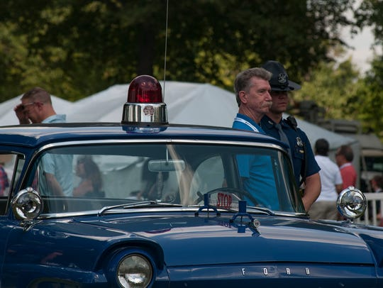 State Police showing off their classic and posing for
