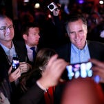 Mitt Romney at the Republican National Committee's annual winter meeting aboard the USS Midway on Friday in San Diego.