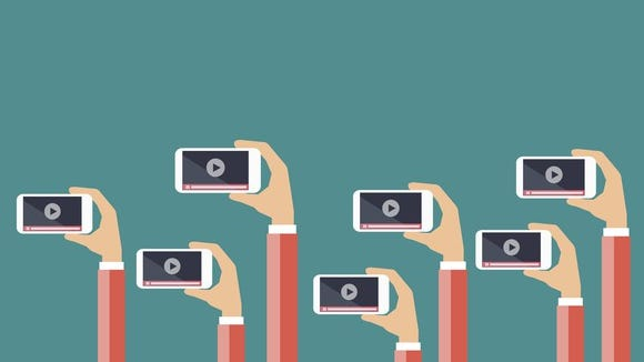 An illustration of people holding mobile phones.