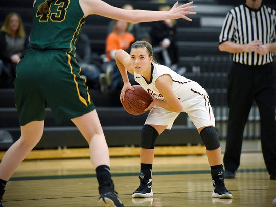 Tech's Mara Weaver plans her move against Sauk Rapids' Angela Konz  during the first half Saturday, Jan. 16 at Sauk Rapids-Rice High School.