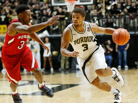 P.J. Thompson works to get past Andrew White III of Nebraska Saturday, January 30, 2016, at Mackey Arena. Purdue defeated Nebraska 89-74.