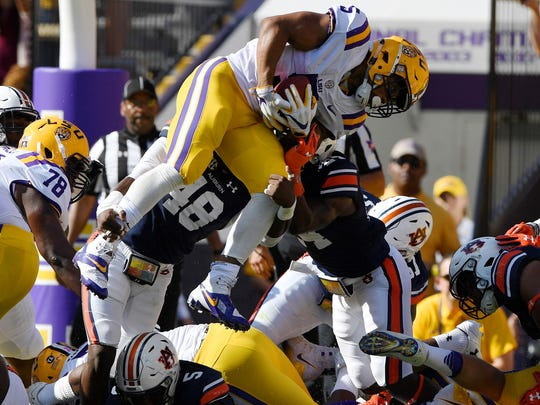 LSU's Derrius Guice is stopped on 3rd down and goal by Auburn linebacker Montavious Atkinson (48) and Auburn defensive back Daniel Thomas (24) in the first half.
