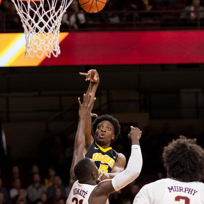 Iowa forward Tyler Cook shoots in the first half against