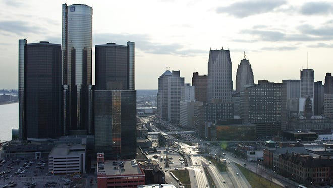 The General Motors world headquarters, in Detroit's renovated Renissance Center, stands on the city's riverfront with the rest of downtown to the right in this aerial view from the city's east side.