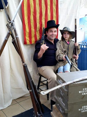 Visitors dress up in Civil War garb for pictures during an event sponsored by the Friends of the Elmira Civil War Prison Camp on Saturday at the Arnot Mall in Big Flats.