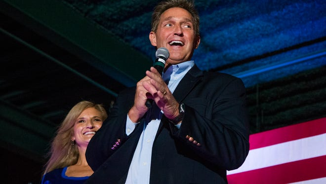 Sen. Jeff Flake, R-Ariz., and his wife, Cheryl, lend their support to Sen. John McCain's re-election campaign on Nov. 3, 2016, at Mesa's Sloan Park.