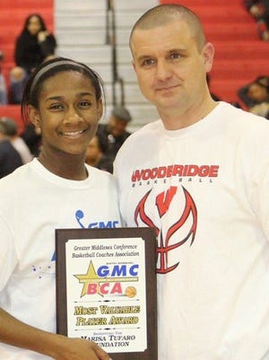 Sayreville's Patrice Harding receives 2017 GMC Girls Basketball All-Star Game MVP plaque from Woodbridge head coach Bobby Timinski. All proceeds from the event benefited The Marisa Tufaro Foundation.