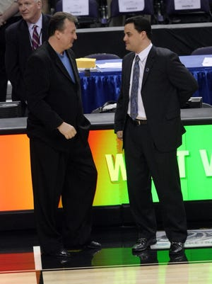 Xavier head coach Sean Miller and West Virginia head coach Bob Huggins talk before the start of a Sweet 16 game in Phoenix in March of 2008.