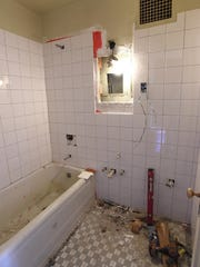 New tile is installed in a bathroom being renovated at the Siegel El Cortez.