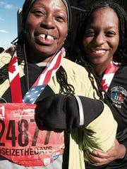 Free Press staffer Cassandra Spratling, with daughter Yemisi Odetoyinbo, celebrates her half-marathon finish and one more bucket-list objective.