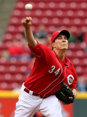 Cincinnati Reds starting pitcher Homer Bailey (34) throws a pitch against the St. Louis Cardinals in the first inning.