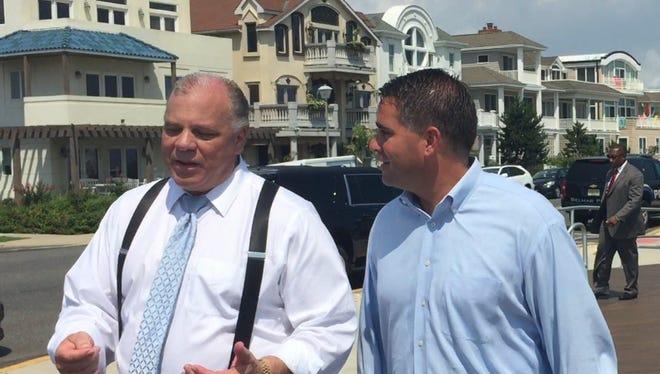 NJ Senate President Steve Sweeney, left and Belmar Mayor Matt Doherty, both Democrats, walk on the Belmar boardwalk after a Wednesday morning news conference on a new Sandy law.