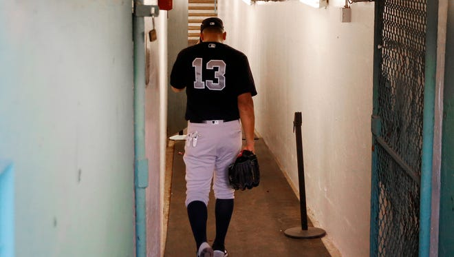 New York Yankees' Alex Rodriguez walks back down the tunnel to the clubhouse before the team's baseball game against the Boston Red Sox at Fenway Park in Boston on Tuesday, Aug. 9, 2016.