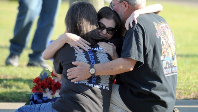 Members of Benjamin J. Deen's family comfort each other at the memorial site for the fallen officer. Tuesday marked the two-year anniversary of the deaths of Hattiesburg police officers Deen and Liquori Tate.