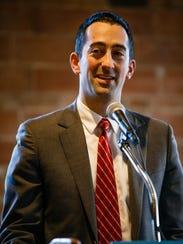 City Council candidate Josh Mandelbaum speaks during