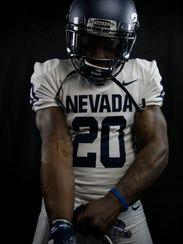 James Butler shows off Nevada's new uniforms.