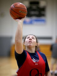 Olympic College's Lexi Ioane practices her shooting form at Bremer Student Center Gym.