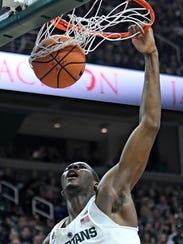 Michigan State's Jaren Jackson Jr. dunks during the