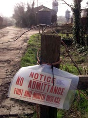 A sign is seen outside Farringford Farm at Freshwater