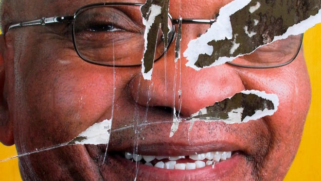 A torn African National Congress (ANC) election poster shows the face of ANC president Jacob Zuma, revealing that not all South African's want the ANC to remain in power, Soweto, South Africa, April 20, 2009.(reissued Feb. 11, 2018).