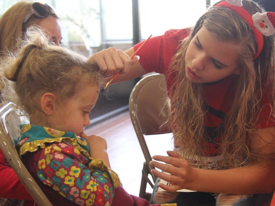 Kinsley Jaquess, 3, gets her face painted at the Living