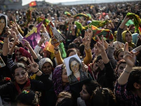 Kurdish people during a celebration rally near the