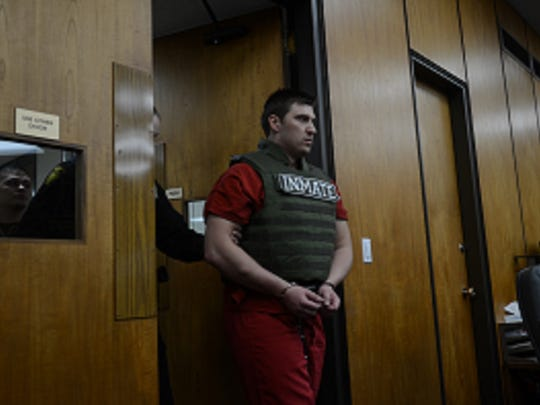 A Washoe County deputy escorts Jason Brown, 25, of Reno into the Washoe County District Court for a sentencing hearing on Thursday in downtown Reno.