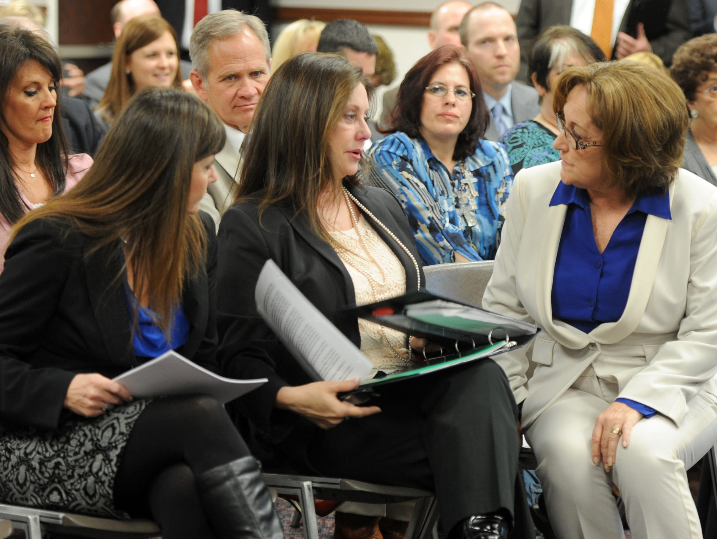 Jayann Sepich, left, and Bridgette Denison talk with Sen. Debbie Smith, right, before the judiciary hearing March 14, 2013. Smith sponsored the bill known as Brianna's Law.
