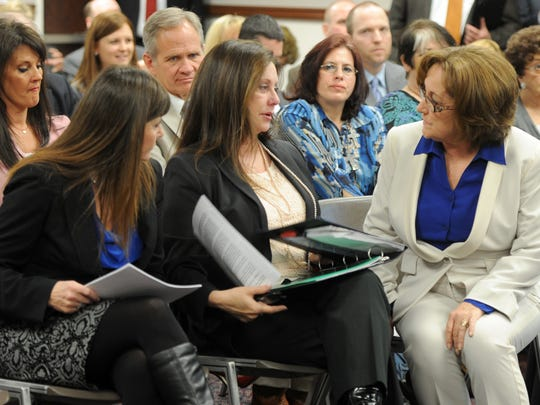 Jayann Sepich, left, and Bridgette Denison talk with Sen. Debbie Smith, right, before the judiciary hearing March 14, 2013. Smith sponsored the bill known as Brianna's Law. Sitting behind Denison is Ed Smart, whose daughter was kidnapped and held hostage for years.