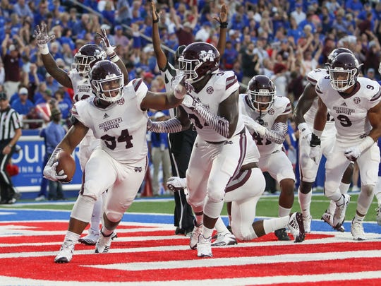 Mississippi State's Jeffery Simmons (94) celebrates a blocked punt for a touchdown.