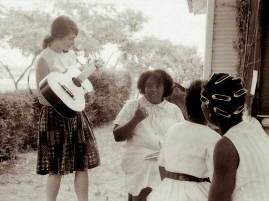 Fannie Lou Hamer, center, chats with Heather Booth,