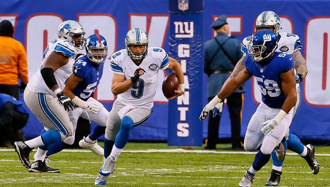 Detroit Lions quarterback Matthew Stafford (9) runs for yardage against the New York Giants during second half at MetLife Stadium. The Giants won 17-6.