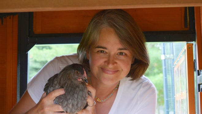 Amy Smith with her chicken Daisy, a Blue Copper Maran