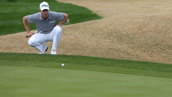 Webb Simpson lines up a putt on the fifth hole at PGA
