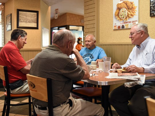 State Sen. Rick Jones, R-Grand Ledge, right, has coffee with friends and constituents on Monday, May 29, 2018, at the A&W in Grand Ledge. Jones has held these breakfast sessions most days since he joined the state House in 2005.