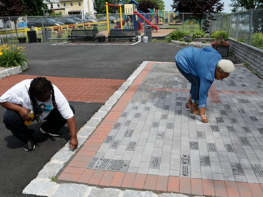 """Virgina """"Ginny"""" Norfleet and Lashana Kee do some weeding at the Haverstraw African-American Memorial Park in the Village of Haverstraw on June 11, 2018."""