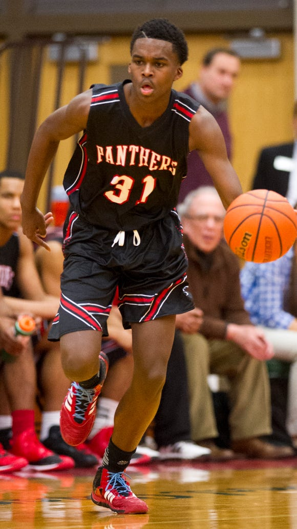 North Central sophomore Kris Wilkes brings the ball up court, Jan. 13, 2015.