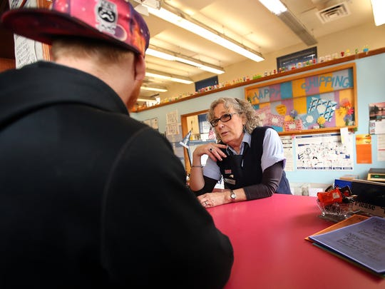 Marj Hendershot helps a customer Monday at the post office on Pacific Avenue in Bremerton.