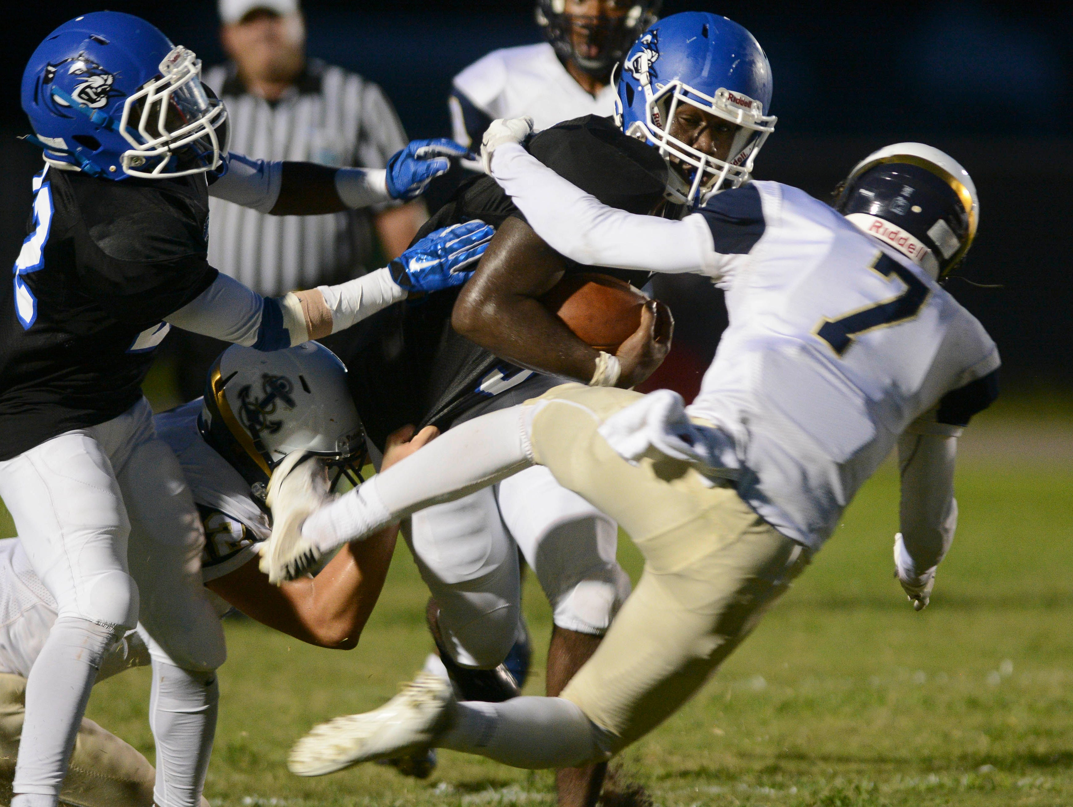 Negail Wright of Heritage is tackled by Josh Moo of Eau Gallie (7) during Friday's game in Palm Bay.