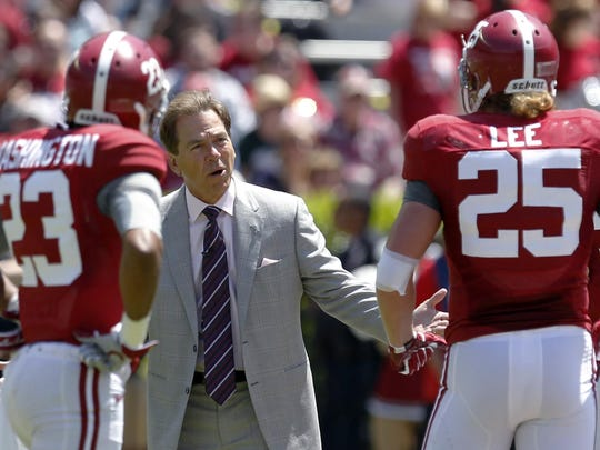 Alabama coach Nick Saban reacts to a breakdown with defensive players Alabama defensive back Jabriel Washington (23) and linebacker Dillon Lee (25) during Alabama's A-Day NCAA college football spring game Saturday, April 19, 2014, in Tuscaloosa, Ala.