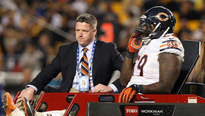 Bears DT Henry Melton was carted off the field Sunday night in Pittsburgh with a season-ending ACL injury.