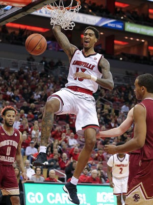 U of L's Ray Spalding (13) slams one down against Boston College during their game at the KFC Yum! Center.  Jan. 21, 2017