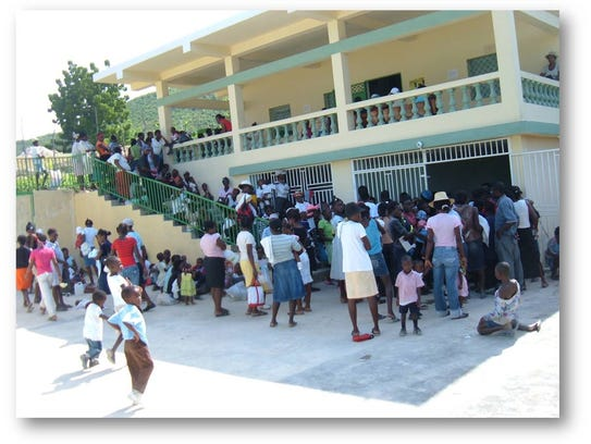 Haitian families flock to Hope Alive! Clinic outside