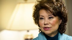 Transportation Secretary Elaine Chao speaks with USA