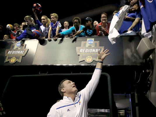 Kansas coach Bill Self signs autographs after practice Wednesday, March 22, 2017, in Kansas City, Mo., in preparation for an NCAA Tournament college basketball regional semifinal game. Kansas faces Purdue on Thursday. (AP Photo/Charlie Riedel)