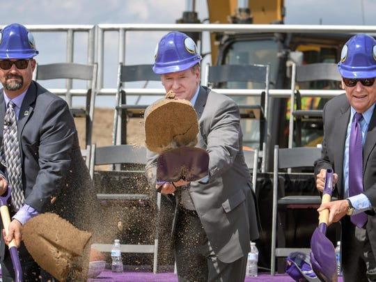NFL Commissioner Roger Goodell, center, Mayor Mike Maguire, left, and Lenny Wilf, right, part of the Vikings Ownership Group, throw shovels full of sand at a groundbreaking ceremony Tuesday for the Minnesota Vikings' new training facility and team offices in Eagan.